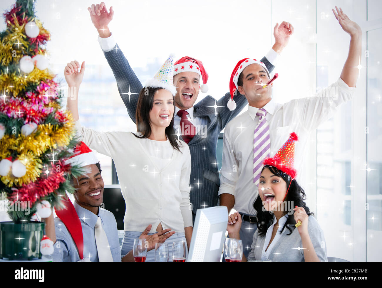 Nice business team punching the air to celebrate christmas - Stock Image