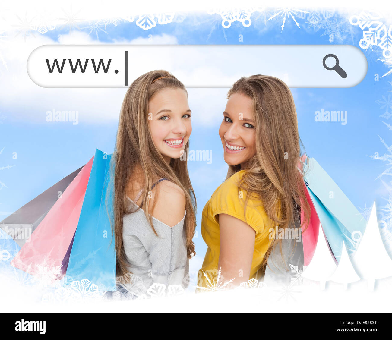 Smiling girls with their shopping bags under address bar - Stock Image