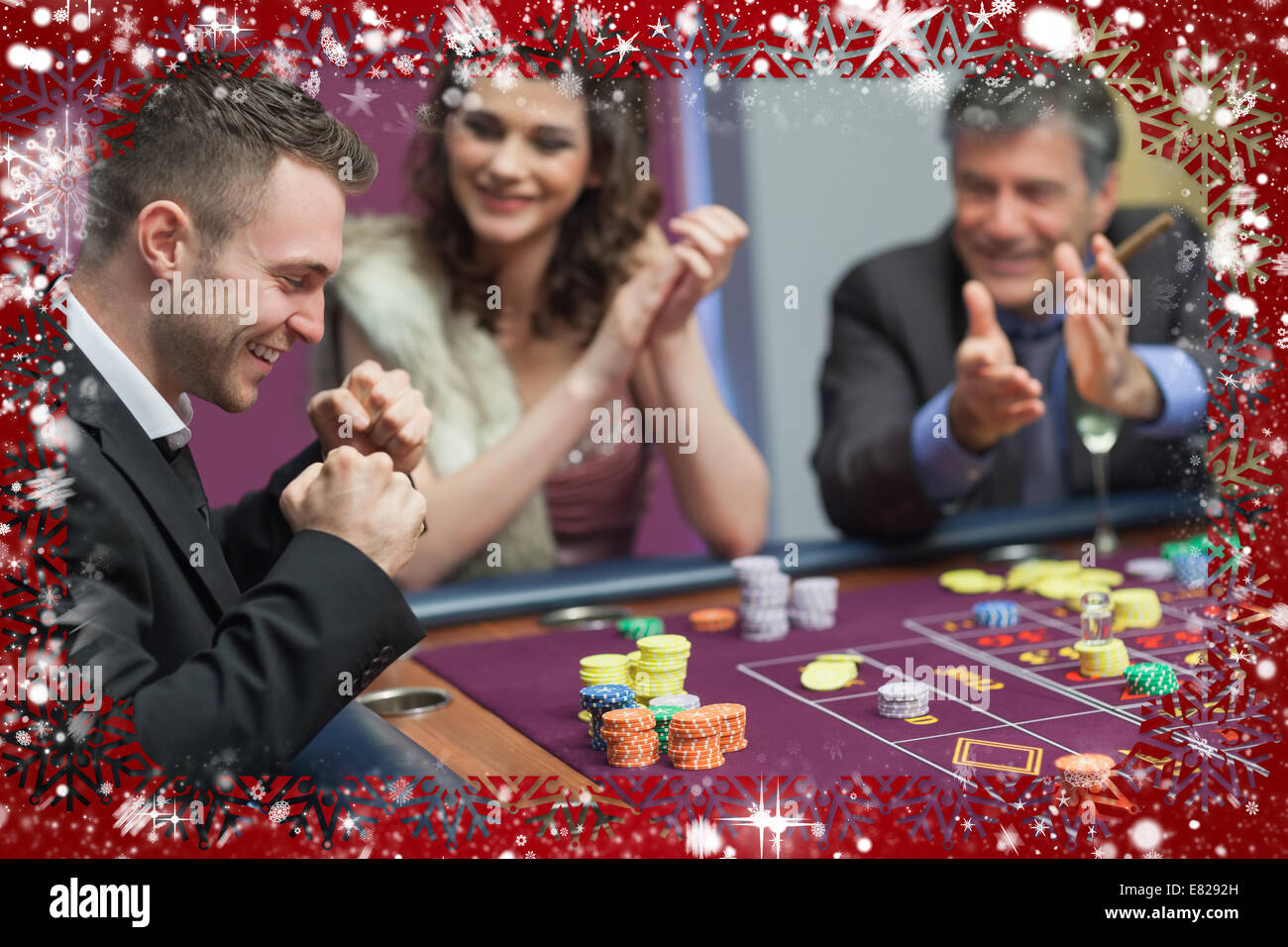 Composite image of people cheering man at craps game - Stock Image