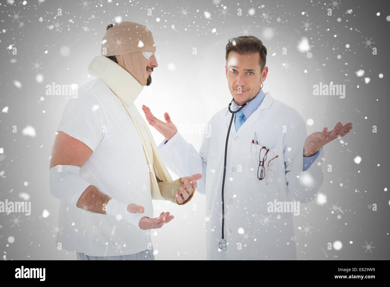 Portrait of a doctor with patient tied up in bandage - Stock Image