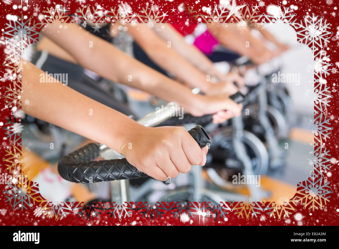 Spin class working out in a row - Stock Image