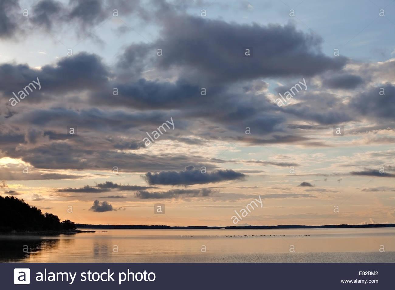Orange summer morning in the archipelago of Southwest Finland - Stock Image