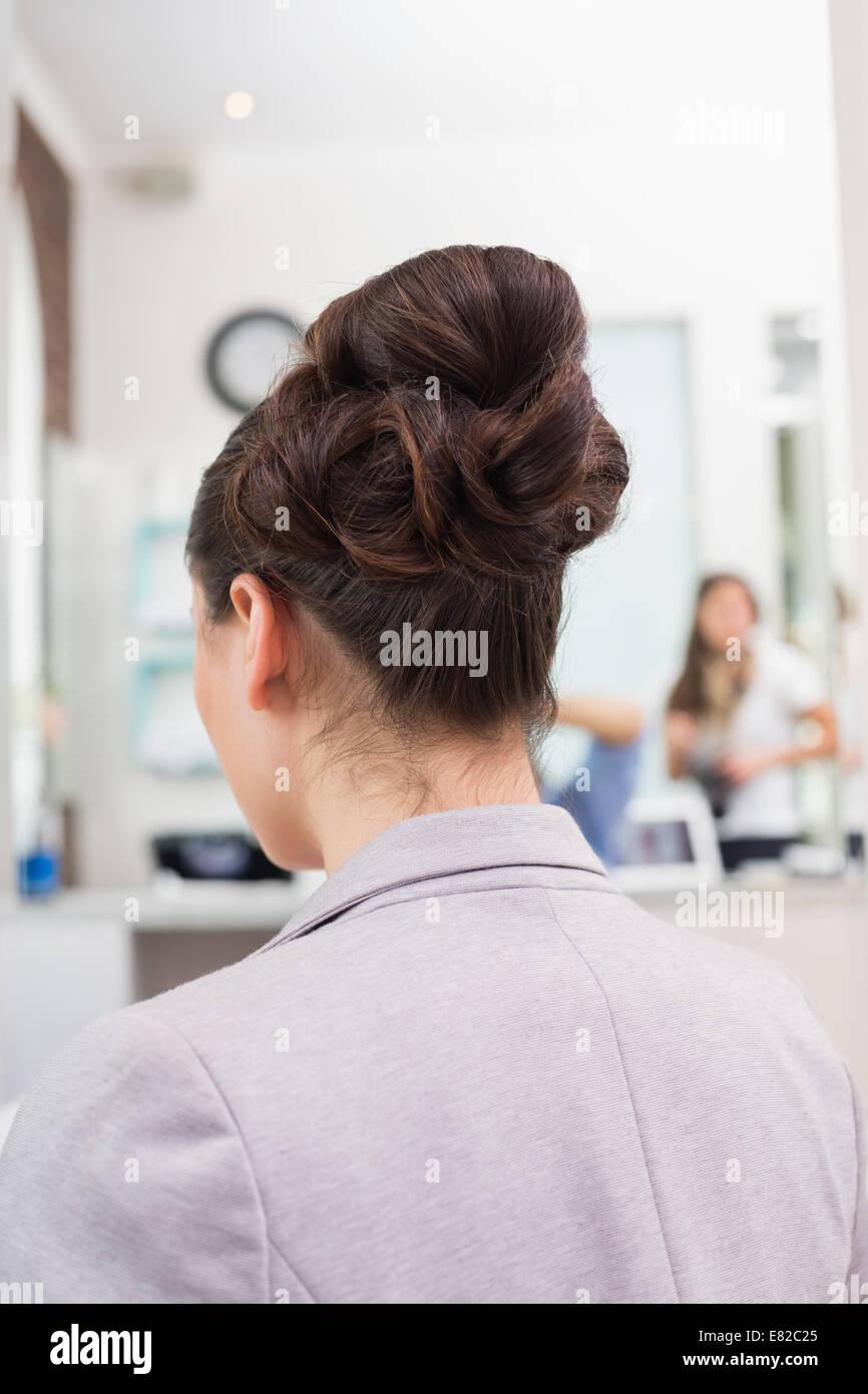 Rear view of brunettes stylish up do - Stock Image