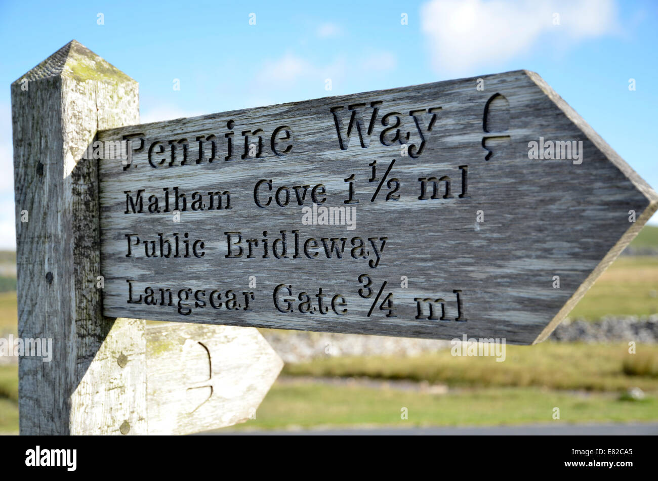 A Pennine Way sign at Malham in the Yorkshire Dales national park. - Stock Image