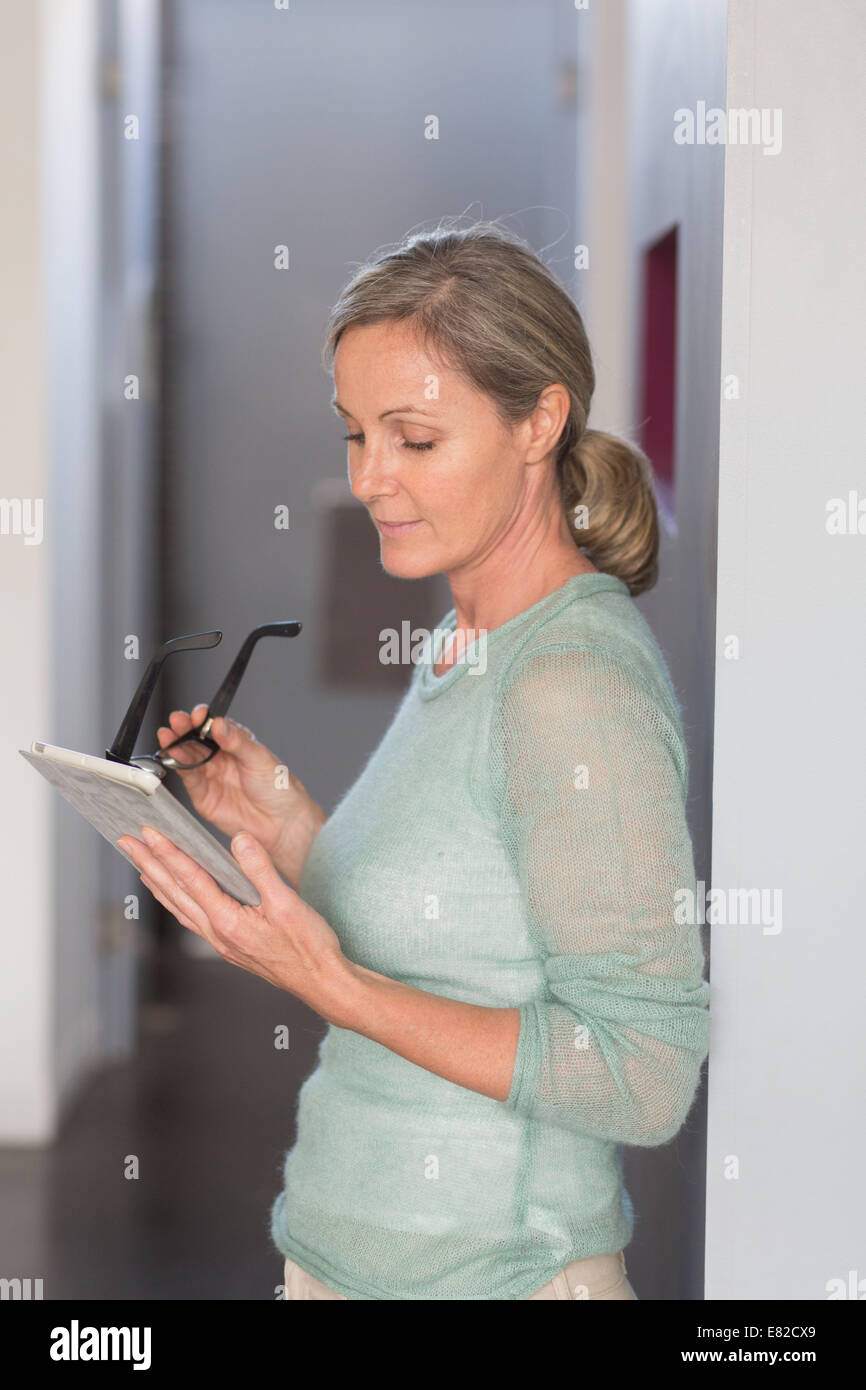 Woman using a digital tablet. - Stock Image