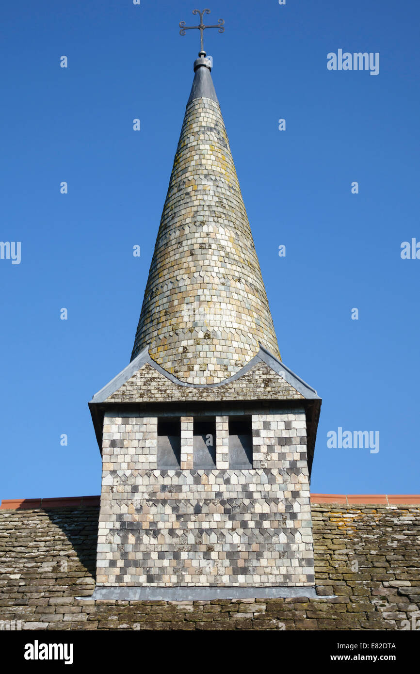 The bellchamber and spire of St Michael's Church, Discoed, Powys, UK. The tower and spire are covered with slate - Stock Image
