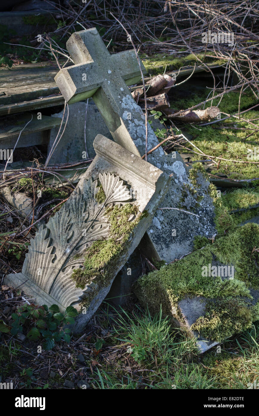 Fallen gravestones in an old Welsh churchyard - Stock Image