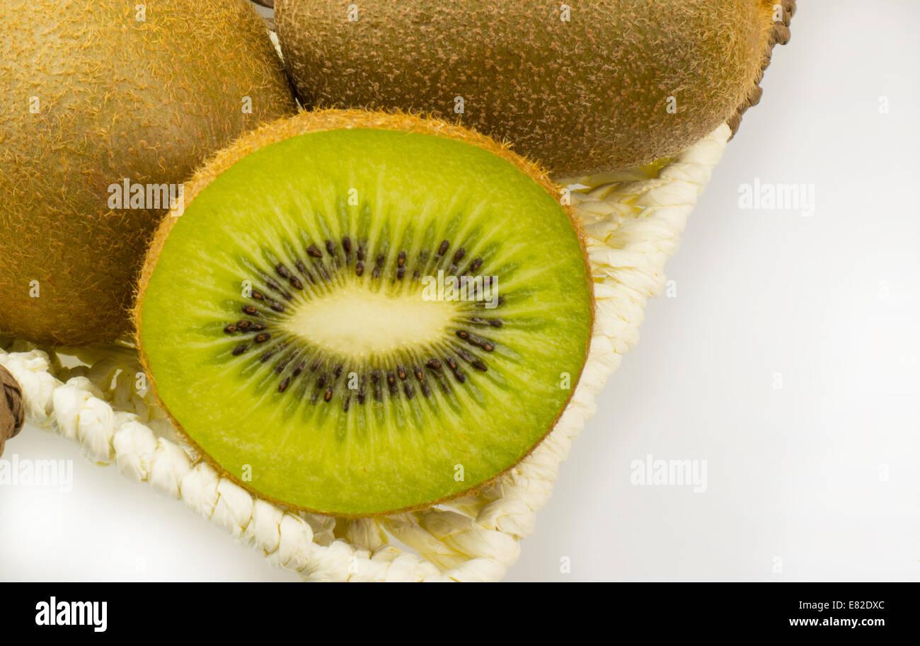Close up of Kiwi Fruit in a basket - Stock Image