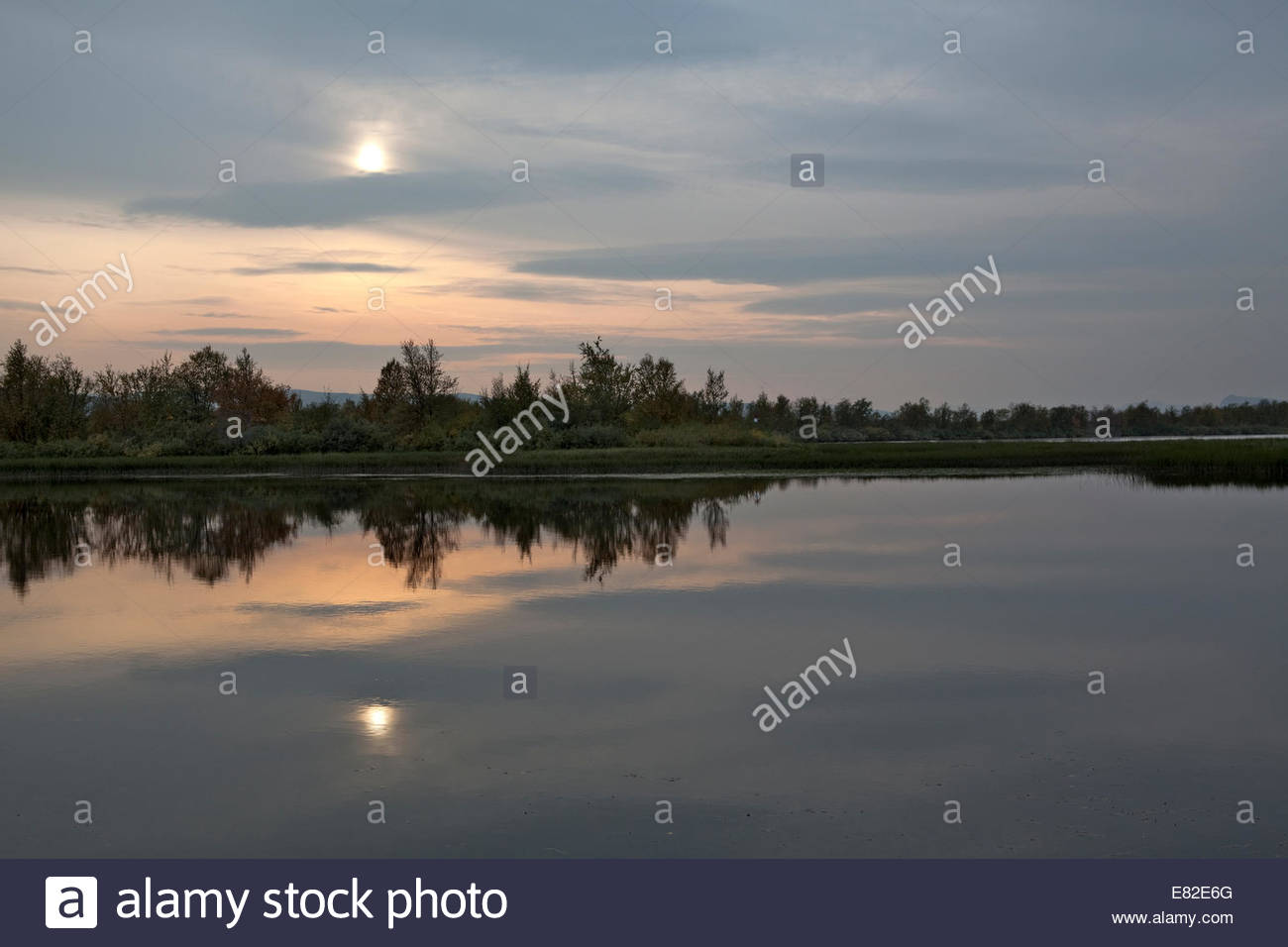 Border river between Finland and Sweden at sunset - Stock Image