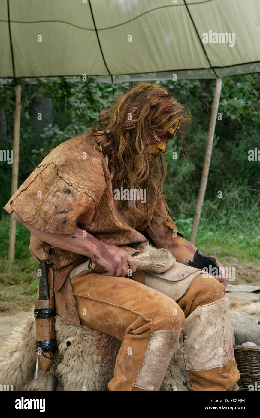 Stone Age flint napping demonstration - Stock Image