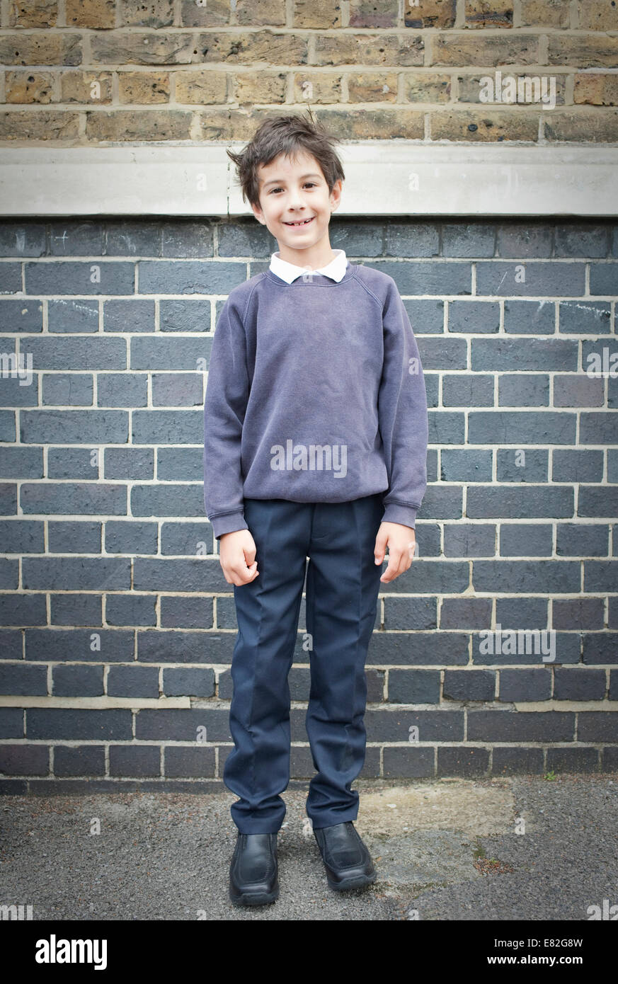 Portrait of boy in playground smiling towards camera - Stock Image