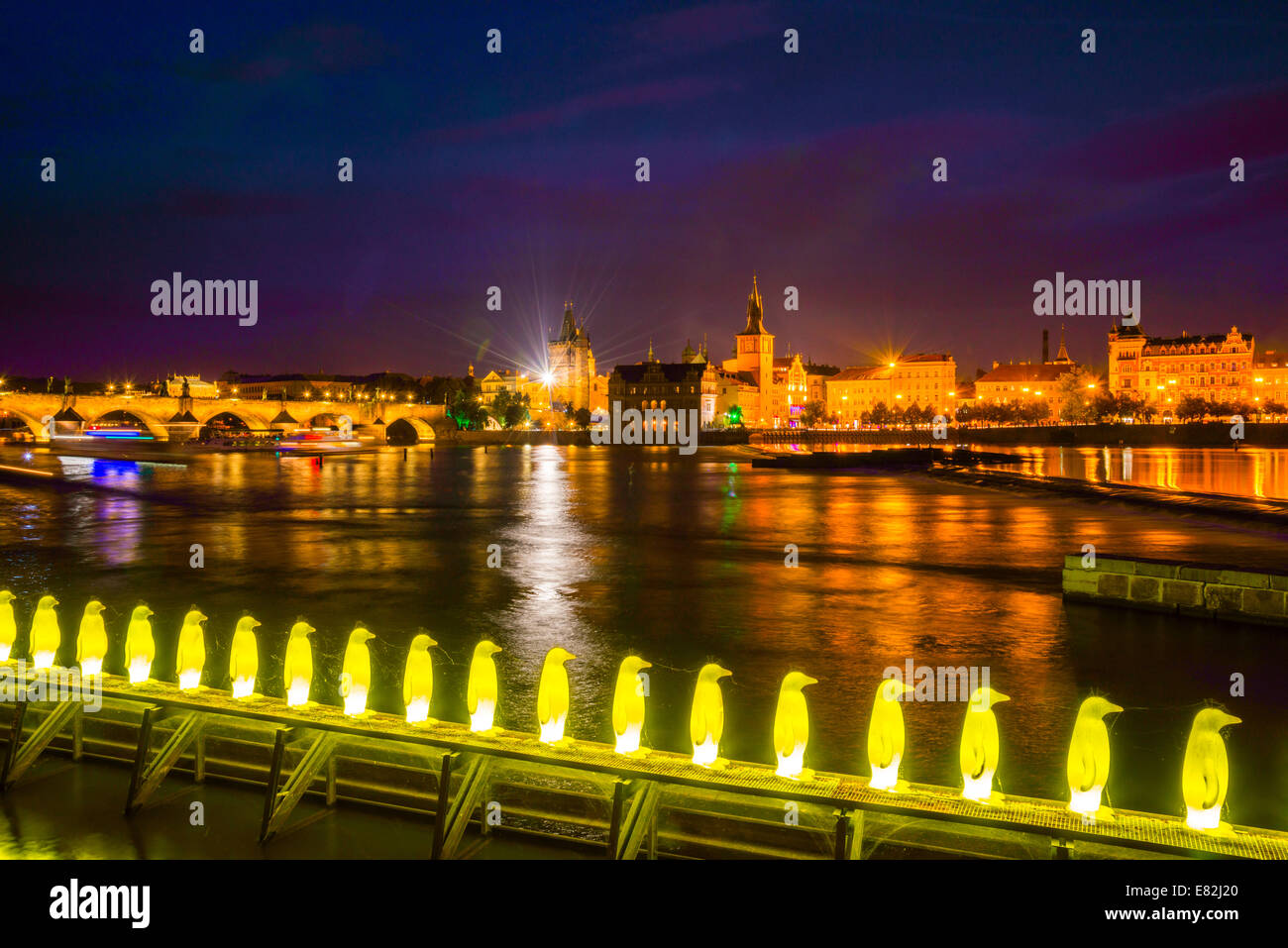 Czechia, Prague, Yellow pinguine figures, Installation of Cracking Art Group at riverside of Vltava, Old town in Stock Photo