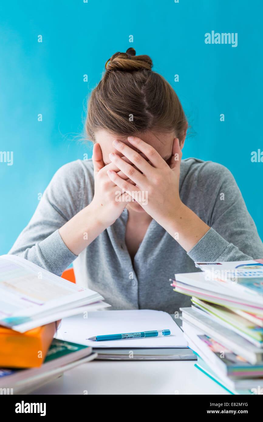 Teenage girl revising exams. - Stock Image