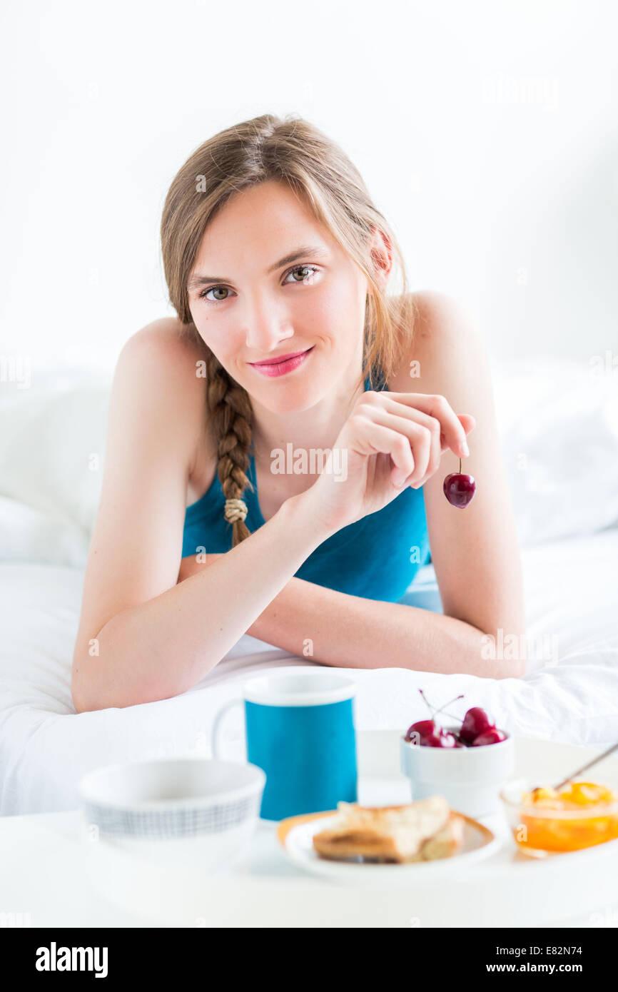 Woman having breakfast. - Stock Image