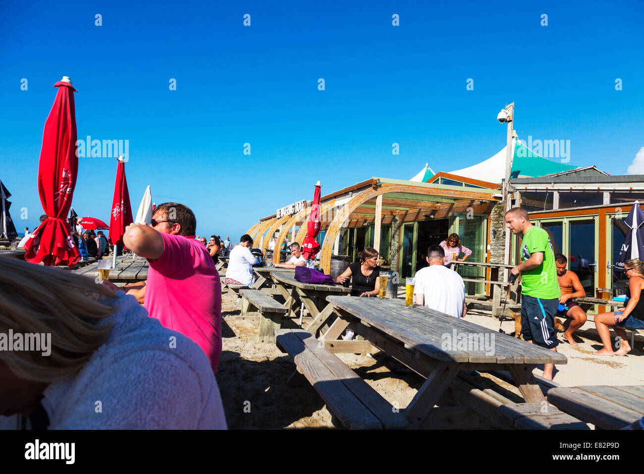 The watering hole pub bar restaurant beach sea front Perranporth Cornwall Cornish west country typical dramatic - Stock Image