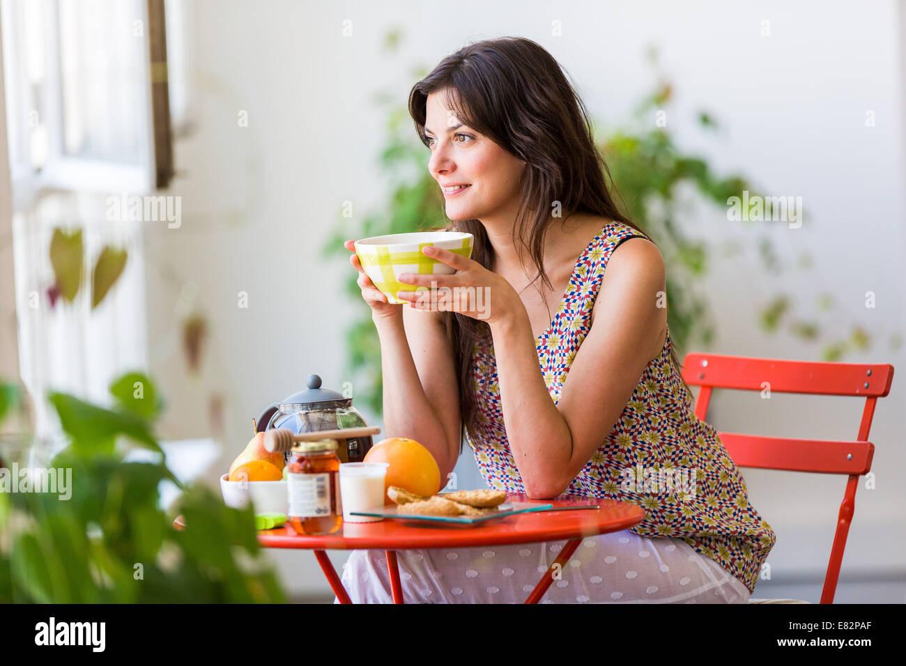 Woman having breakfast. Stock Photo