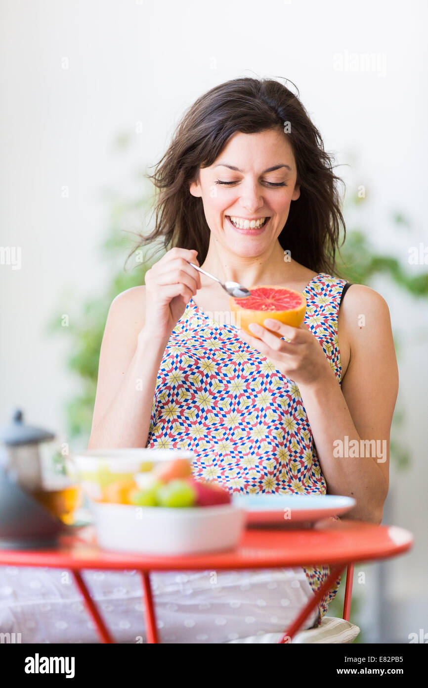 Woman having breakfast. - Stock Image