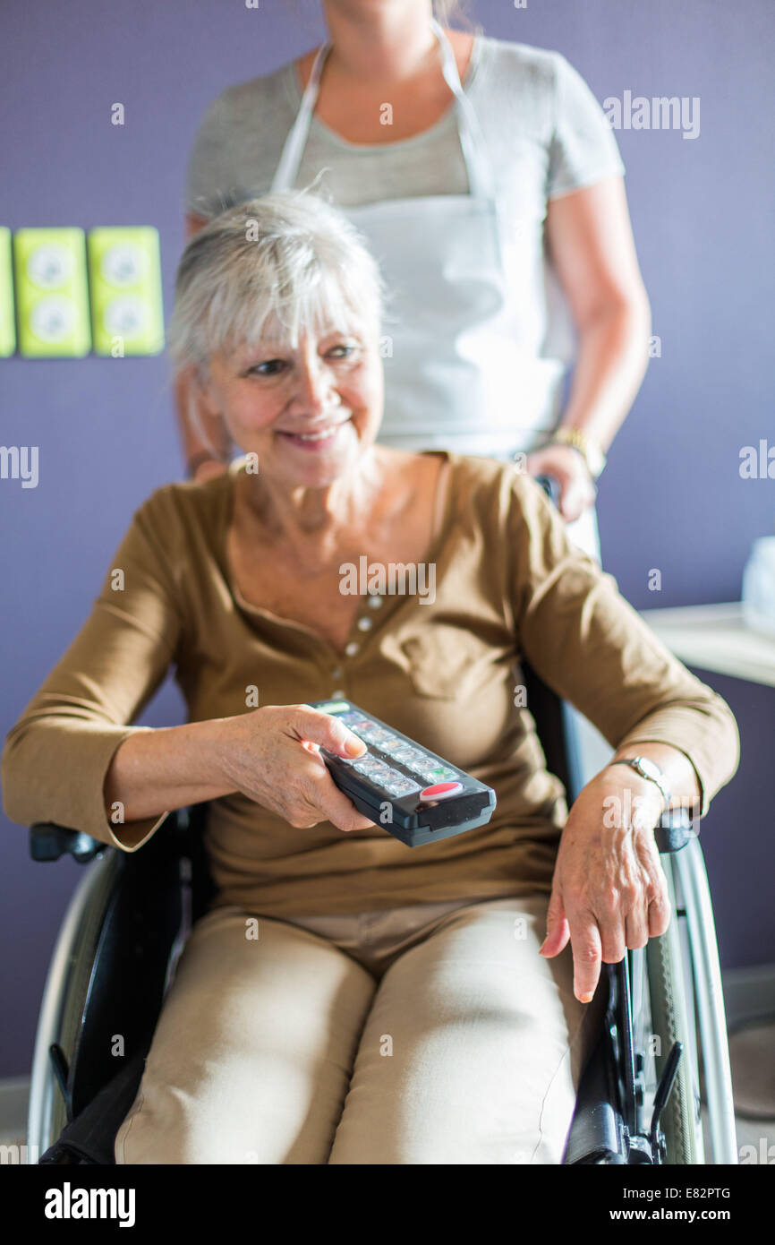 Development of housing for Persons with Reduced Mobility, Here, Using a remote controlling electrical equipment - Stock Image