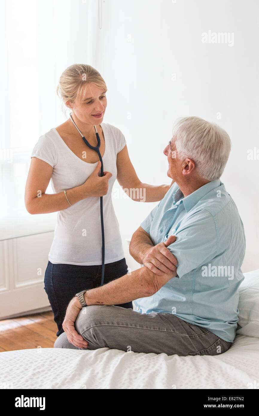 Man discussing with health professional. - Stock Image