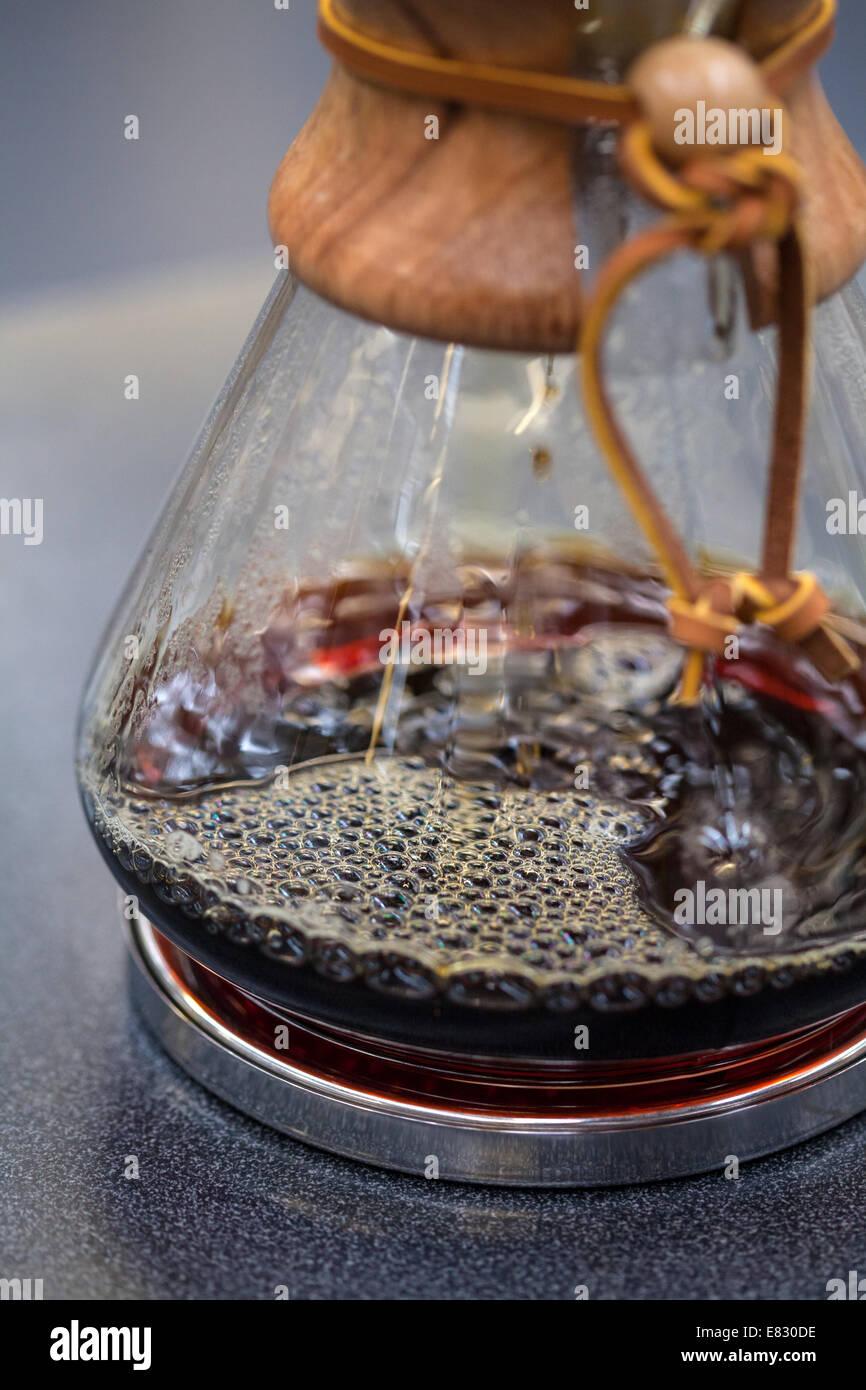 Freshly brewed coffee in Chemex - Stock Image