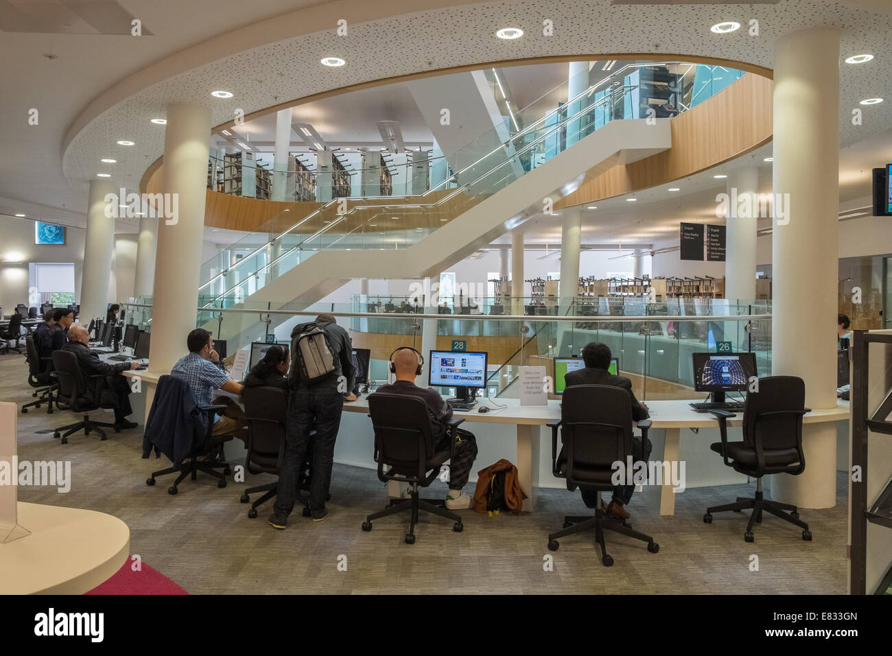 People using computers inside Liverpool Central Library, Liverpool, Merseyside, UK - Stock Image