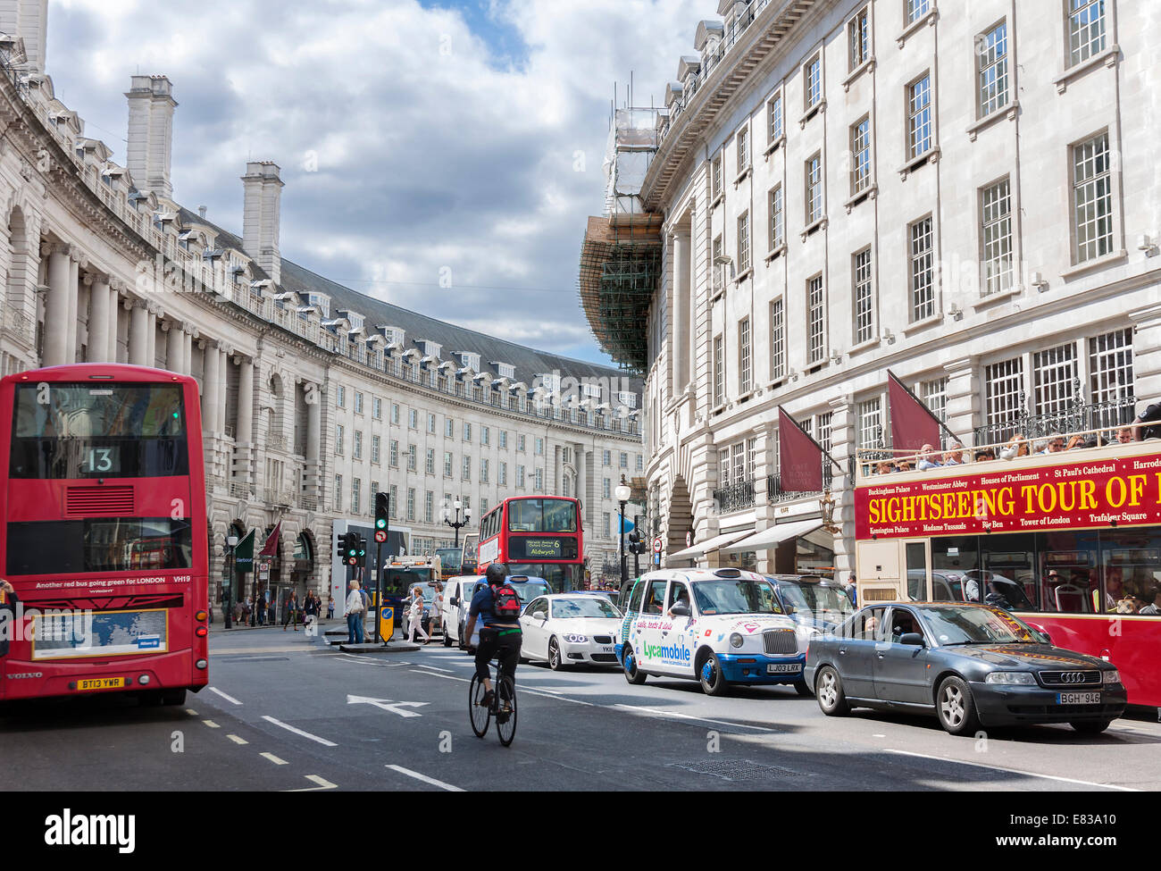 Typical double decker bus in Regent street  in London. Regent Street is one of the major shopping streets in Europe - Stock Image