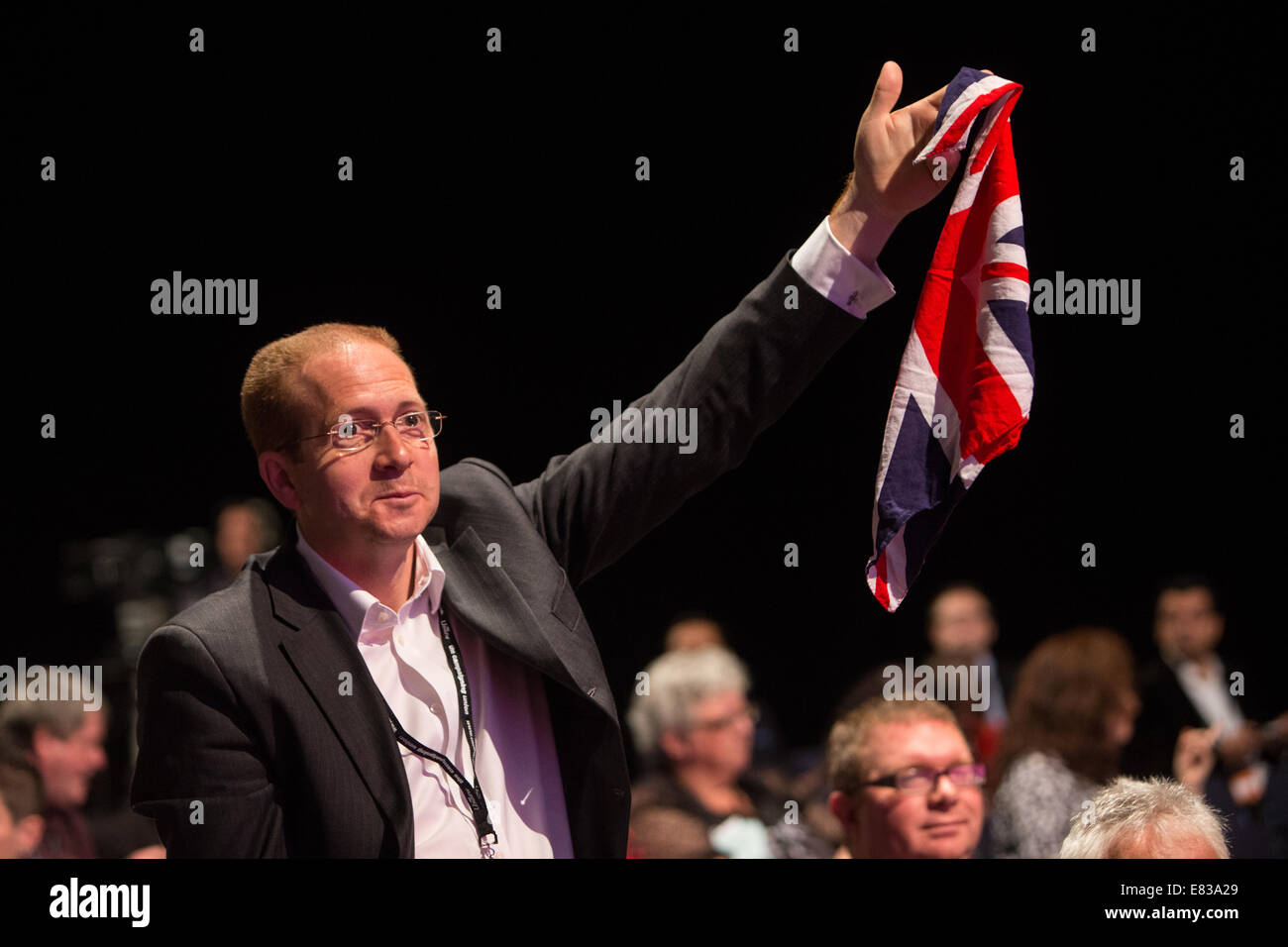 Patriotic delegate,holding up a Union Jack, tries to ask a question at the Labour party conference conference - Stock Image