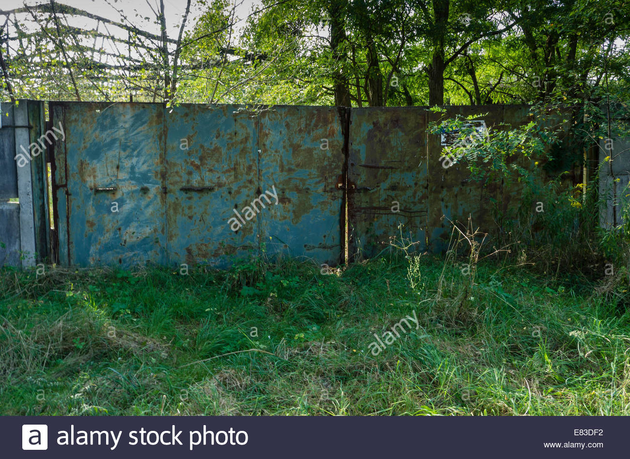 Old Soviet Airfield Finow  former DDR East Germany  Barracks Wall security fence Metal Gate  left behind by Russians - Stock Image