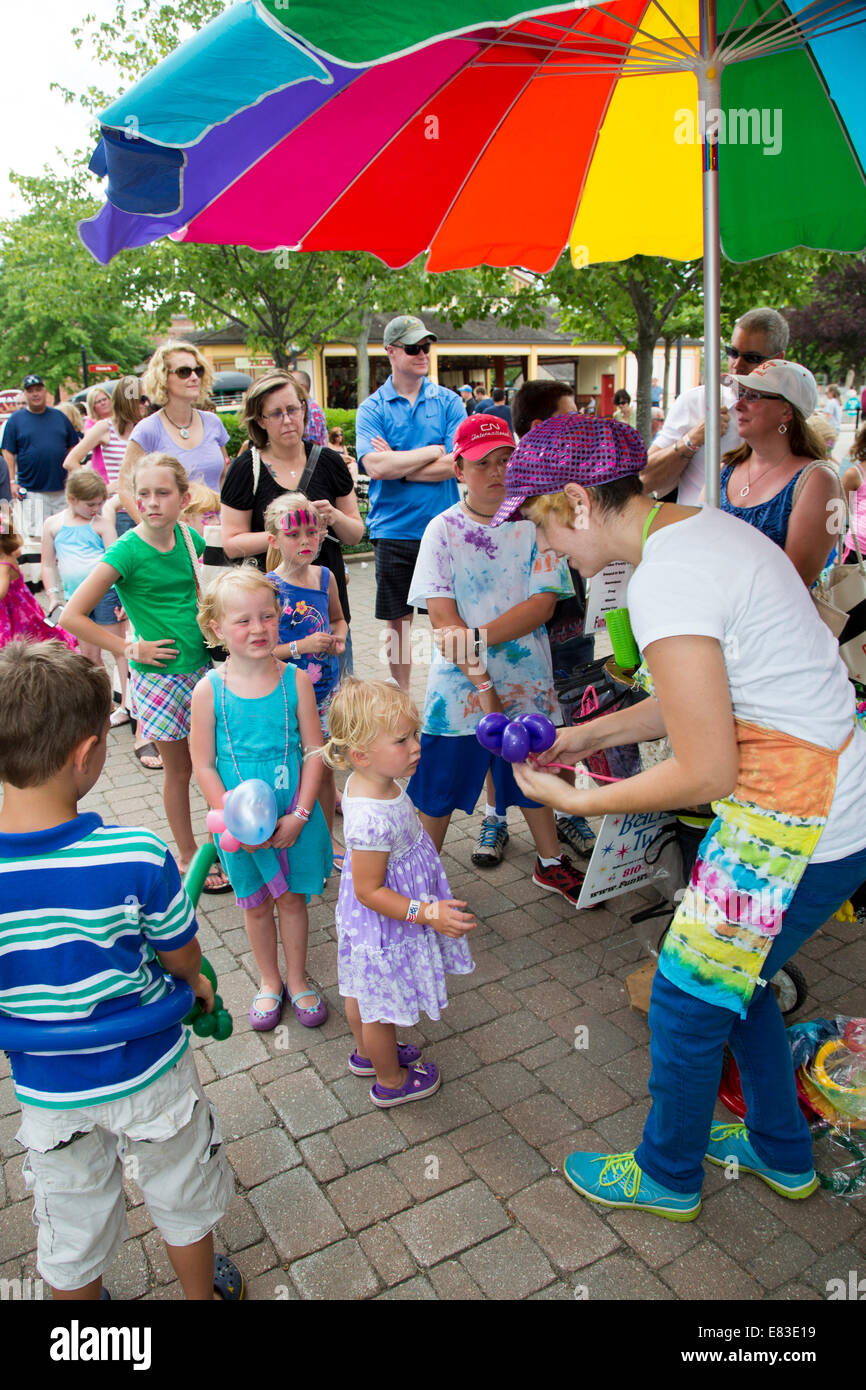 Dearborn, Michigan - Children get balloons during an event at Greenfield Village. - Stock Image