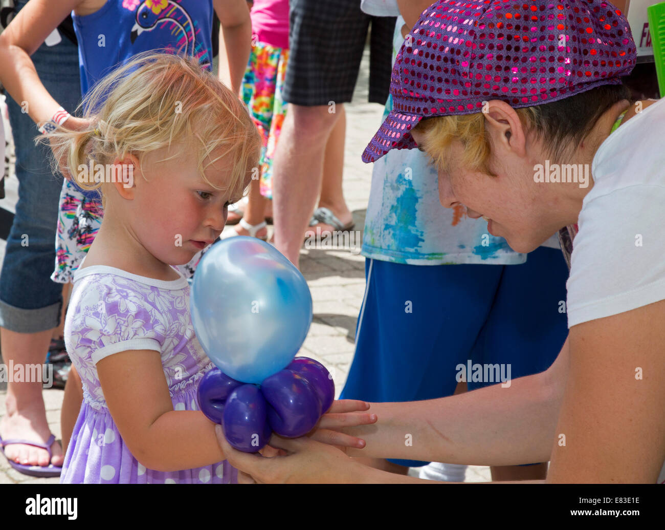 Dearborn, Michigan - A girl gets a balloon during an event at Greenfield Village. - Stock Image