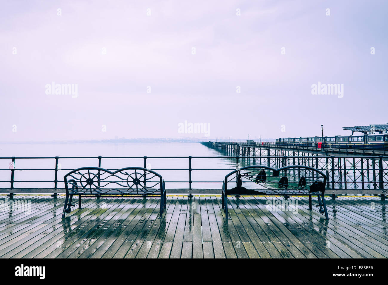 Southend Pier, with blue cross processing effect. - Stock Image