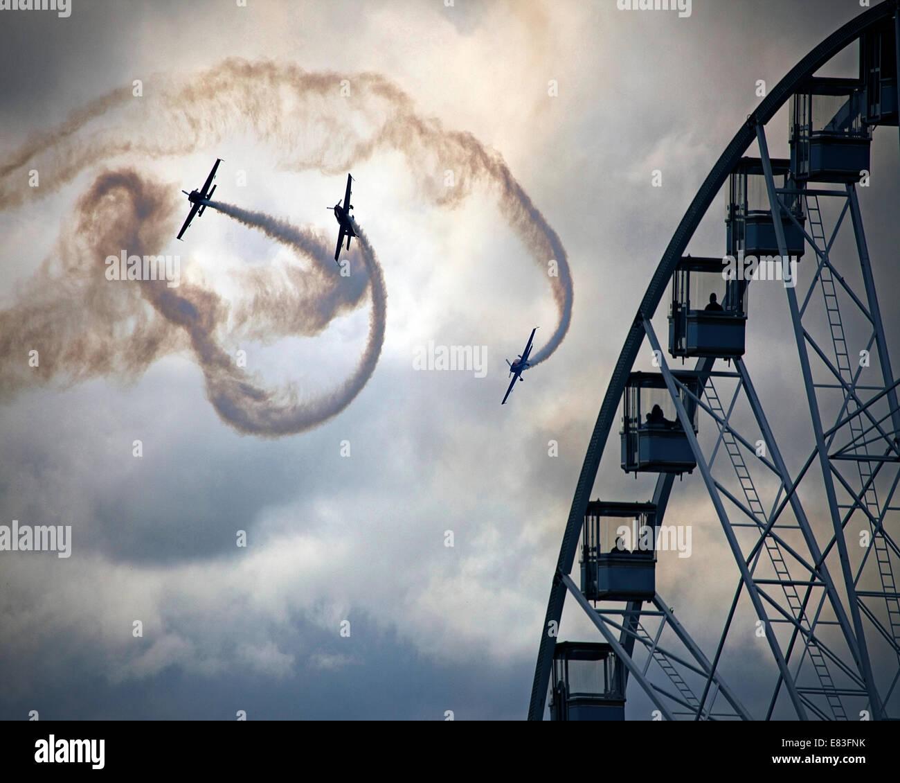 GB - DEVON: Blades Aerobatic Display Team performing over Torquay's Riviera Wheel - Stock Image