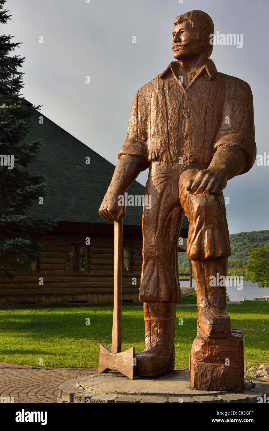Wooden statue of Big Joe Muffraw in Explorers Point Park Mattawa Northern Ontario Canada - Stock Image