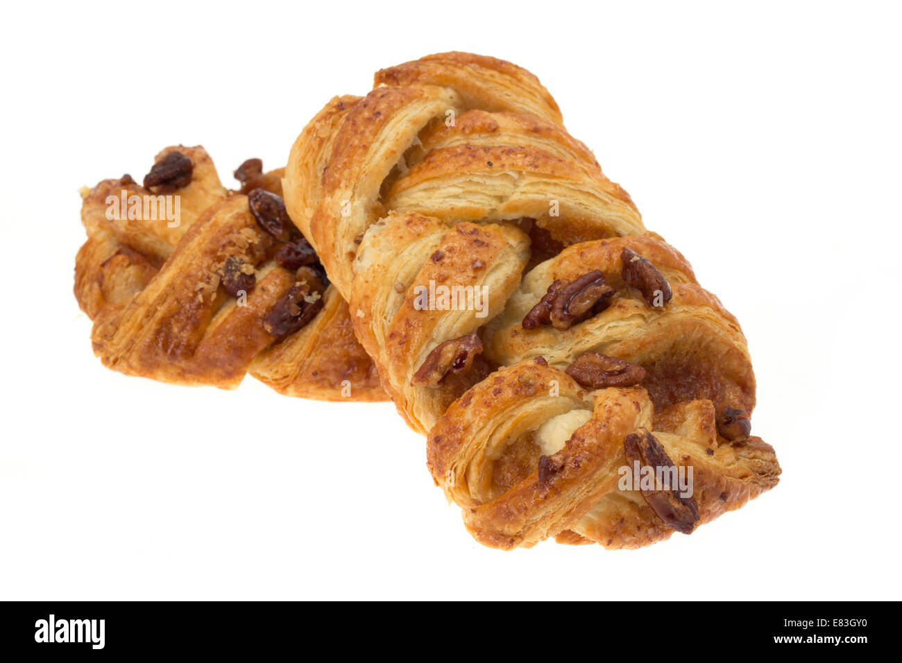 Two pecan plait pastries - studio shot with a white background - Stock Image