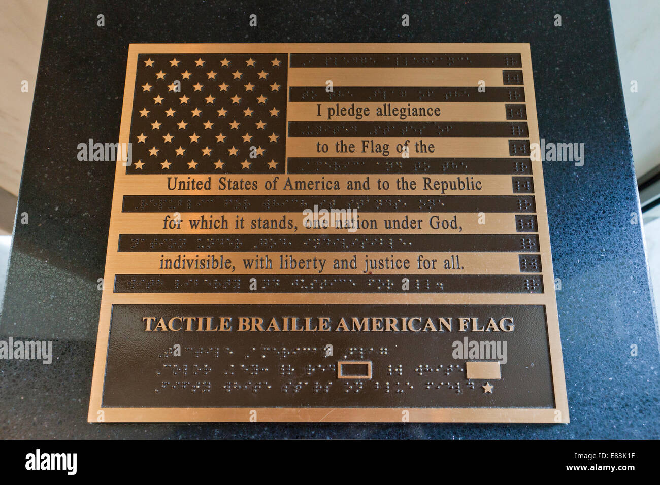 The Pledge of Allegiance of the United States on a brass flag relief including braille - USA - Stock Image