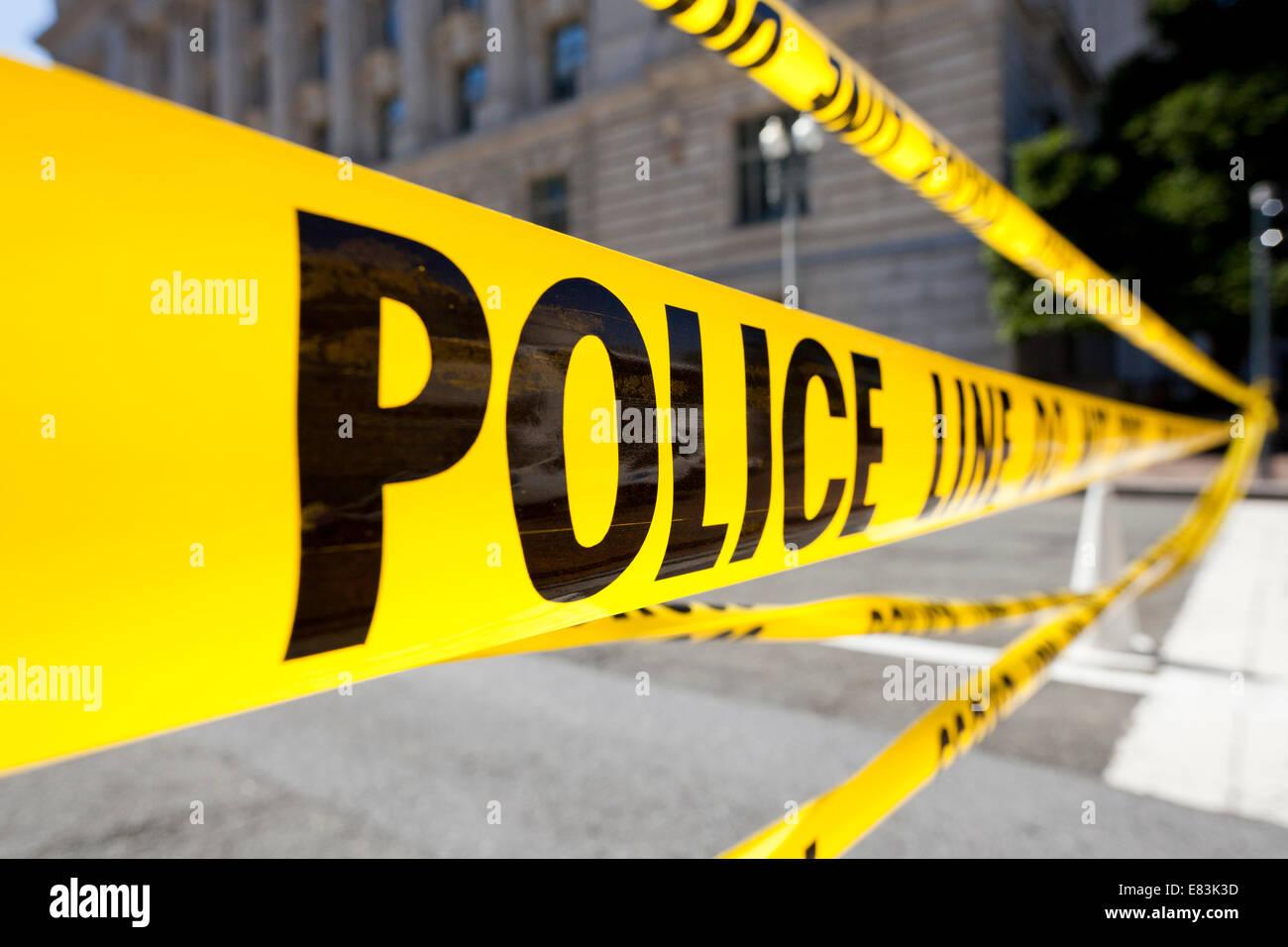 Police line tape closeup - USA - Stock Image
