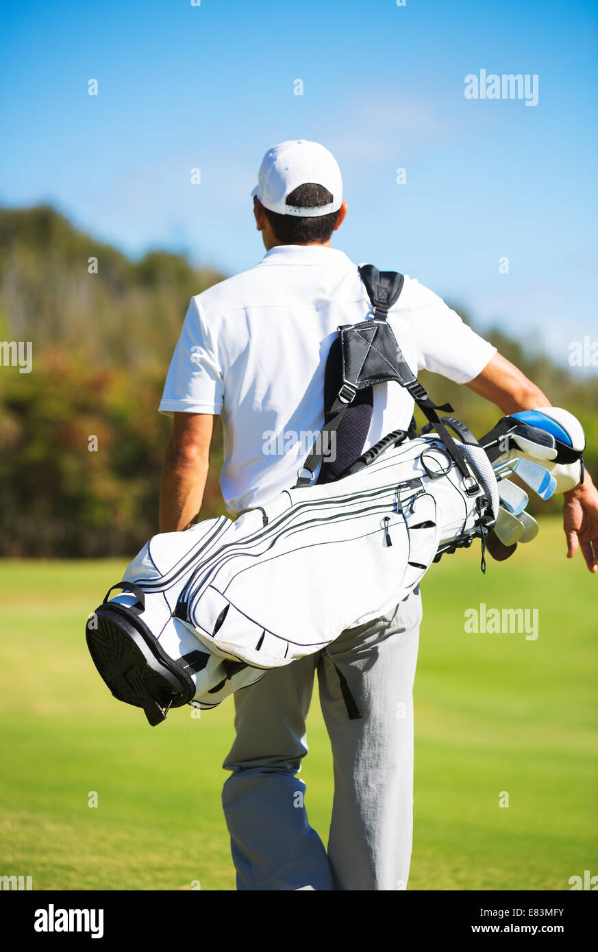 Golfer with Golf Bag Walking down the Course - Stock Image