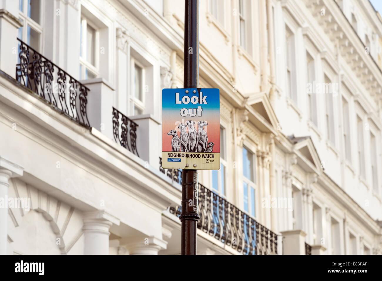 Meerkats on a Neighbourhood Watch street sign, Notting Hill, London, England, UK - Stock Image