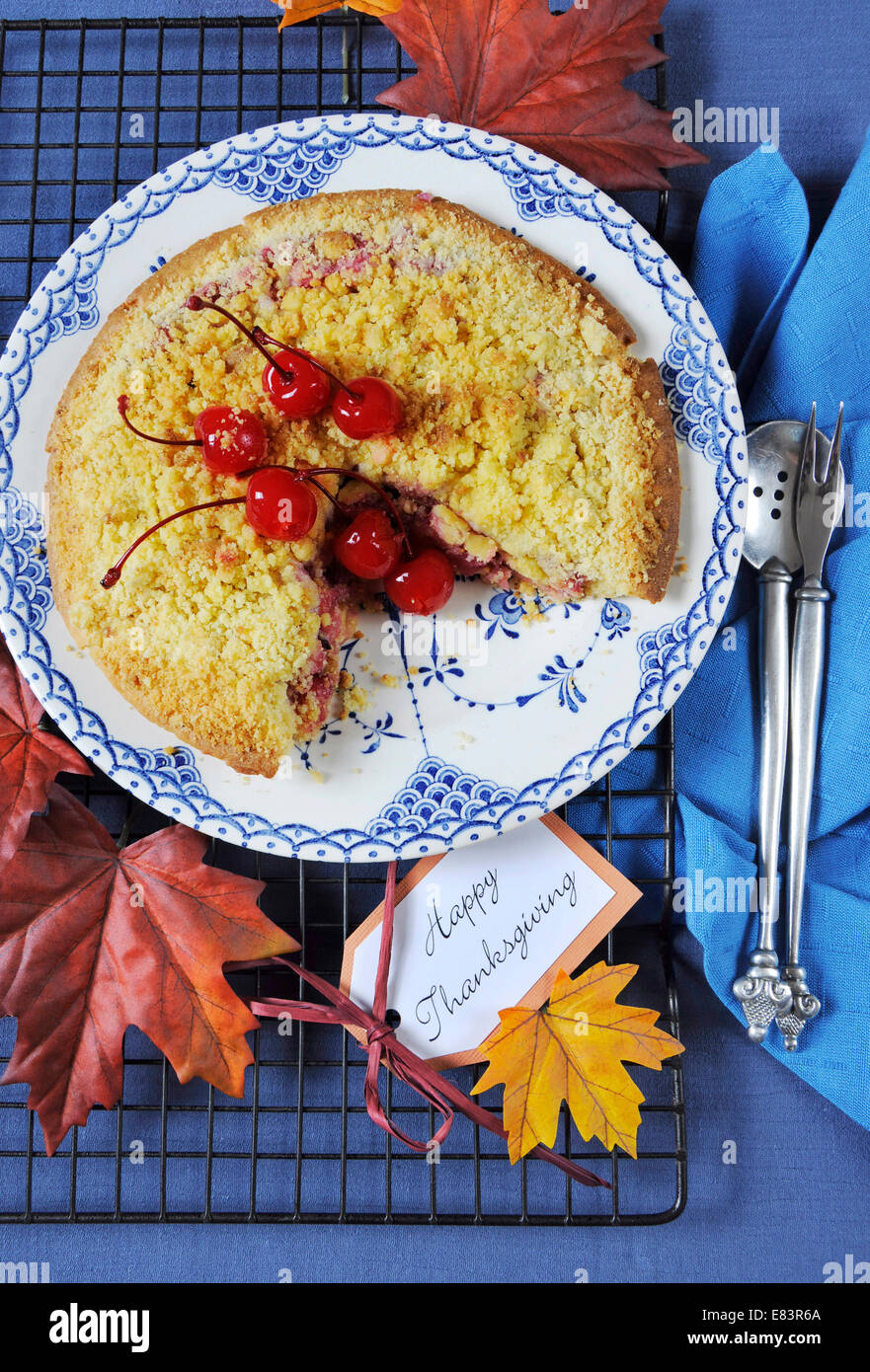 Happy Thanksgiving table setting with cherry apple crumble pie on a vintage blue plate with autumn leaves on blue tablecloth. & Happy Thanksgiving table setting with cherry apple crumble pie on a ...