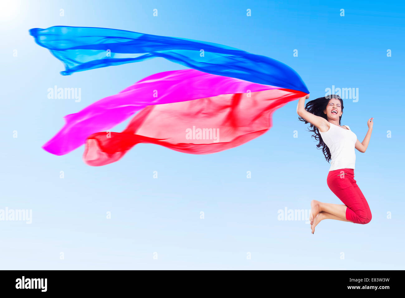 indian Girl Jumping park fun Dupatta - Stock Image