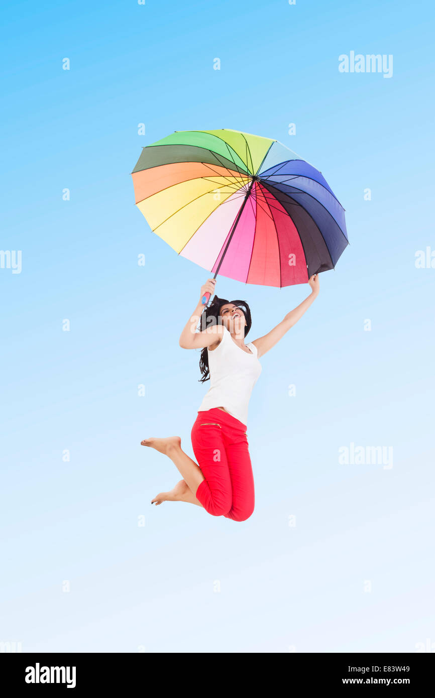 indian Girl Park  Jumping with Umbrella - Stock Image