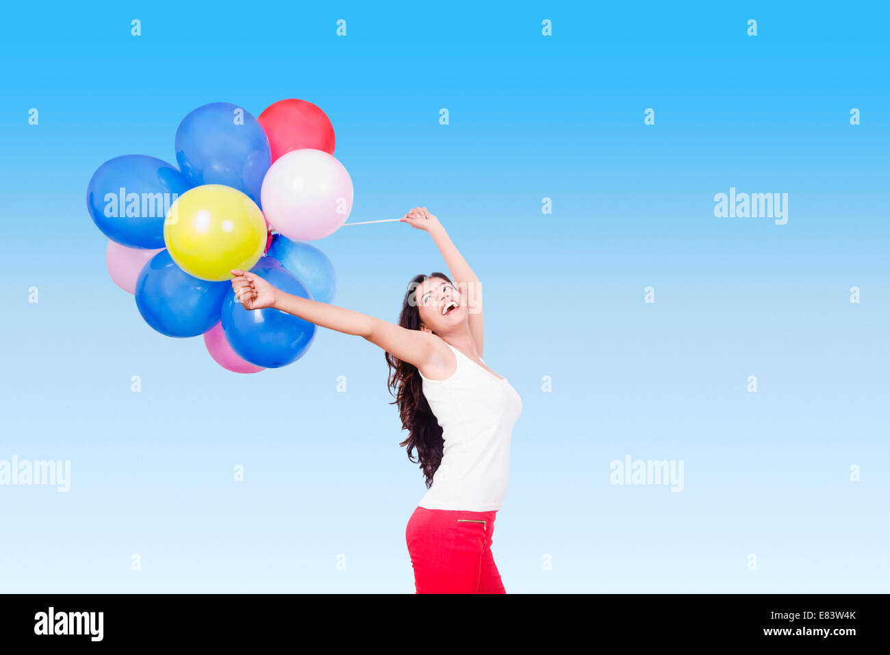 indian Girl Park Fun Balloon - Stock Image