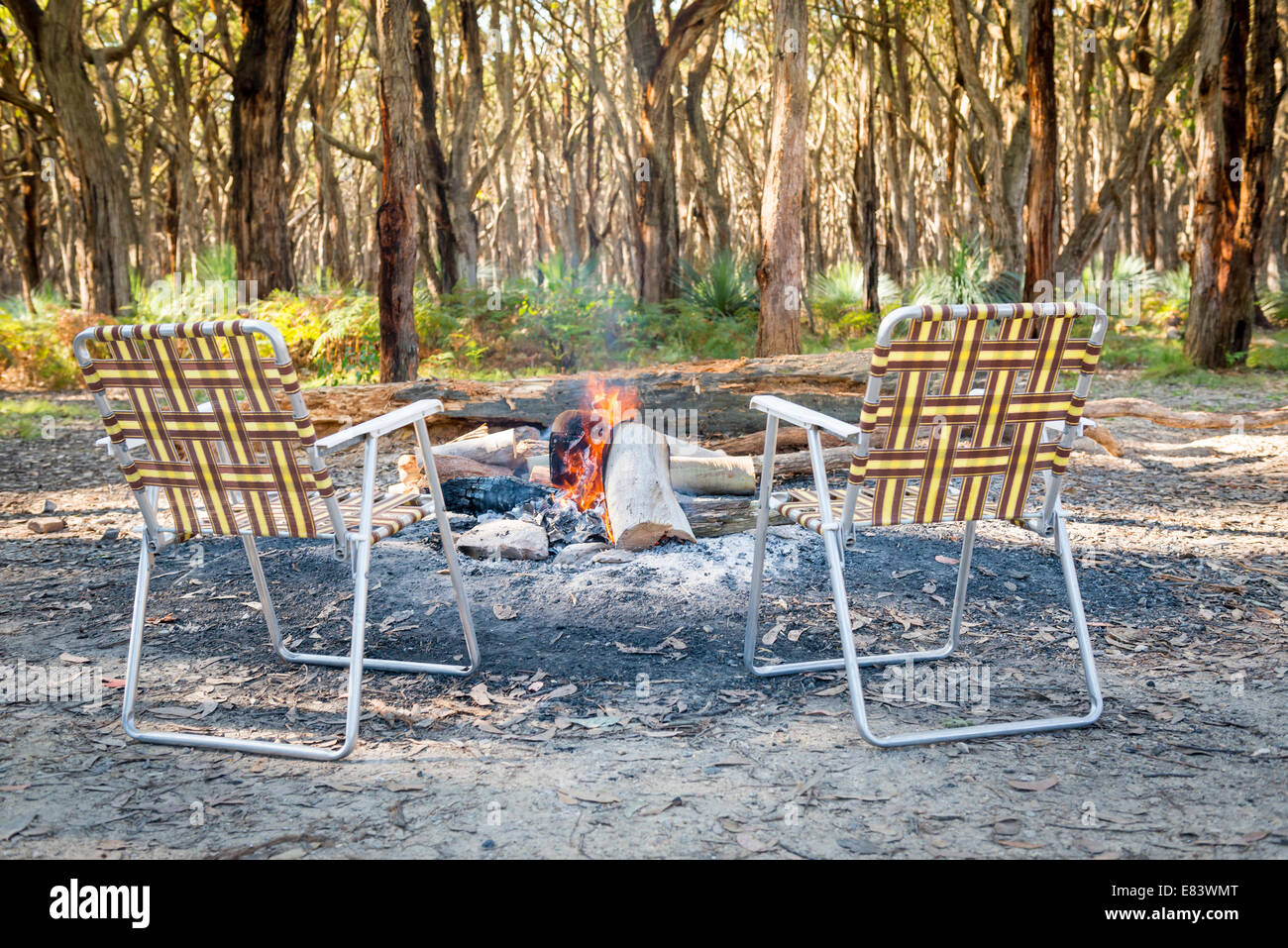 Retro Fold Up Chairs Sitting Around The Campfire In The