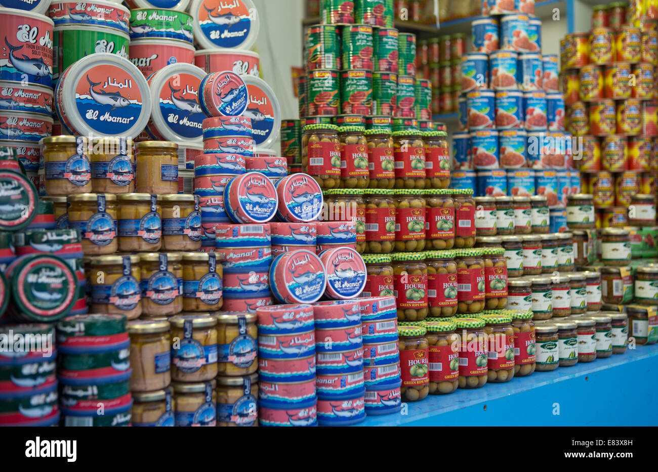 Tinned produce for sale in the Souk of Global Village, Dubai, United Arab Emirates. - Stock Image