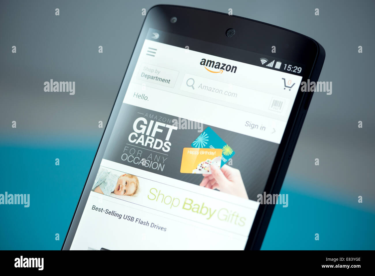 Clouse-up shot of brand new Google Nexus 5, powered by Android 4.4 version, with Amazon website page on a screen. - Stock Image