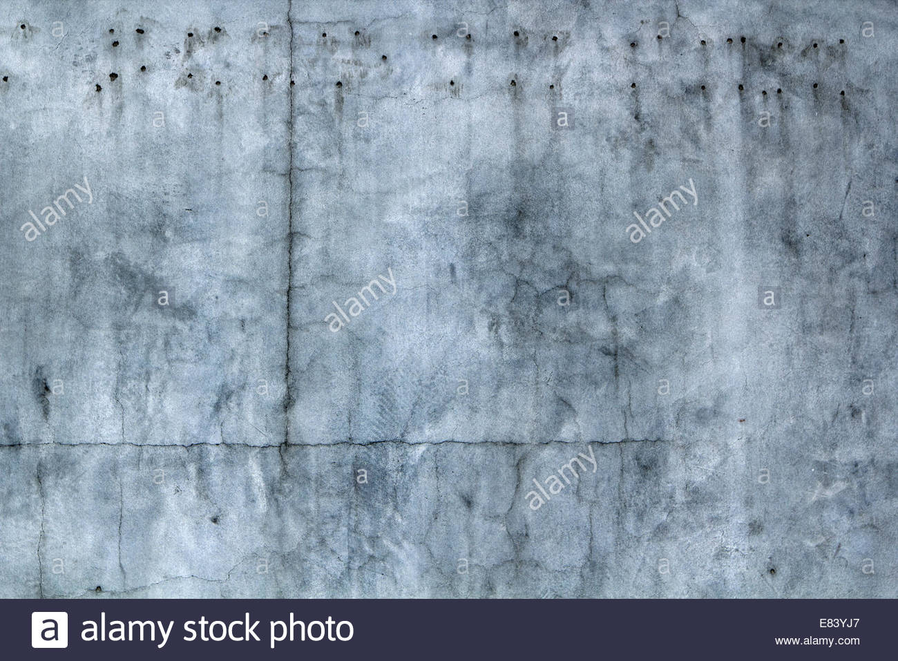 Abstract old aged concrete background texture with cracks, dirt & stains - Stock Image