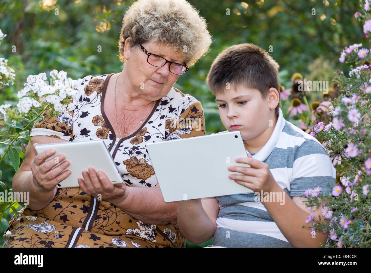grandma grandson watching tablet pc stock photos grandma grandson