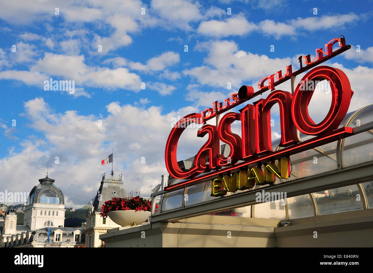 Neon sign of the Casino Evian in front of Town Hall and the Art Nouveau building of the Source Cachat, Evian-les - Stock Image