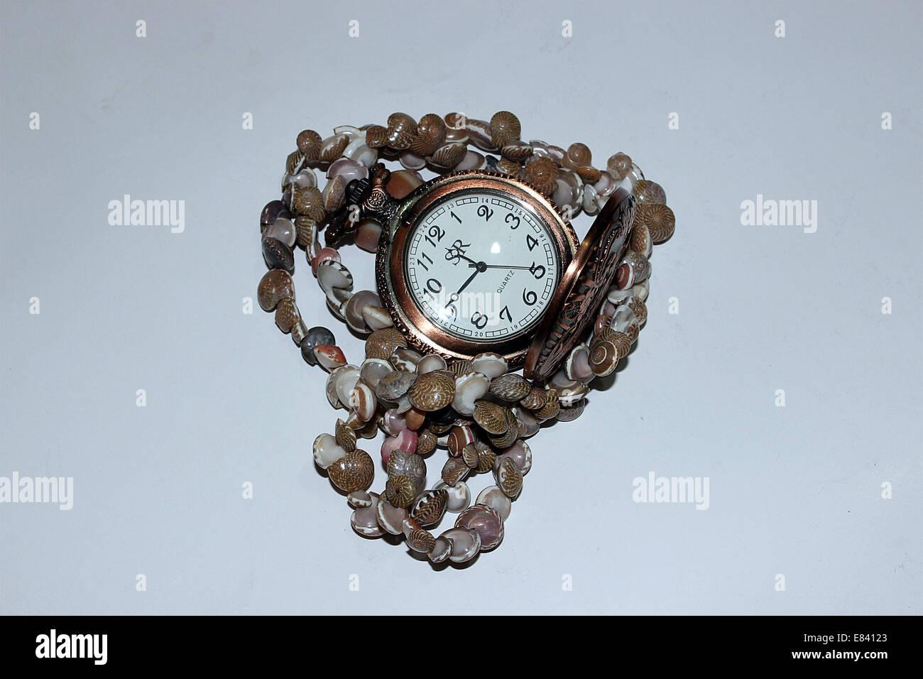Watch,still-life,chronometer,artifact,beads,shells - Stock Image