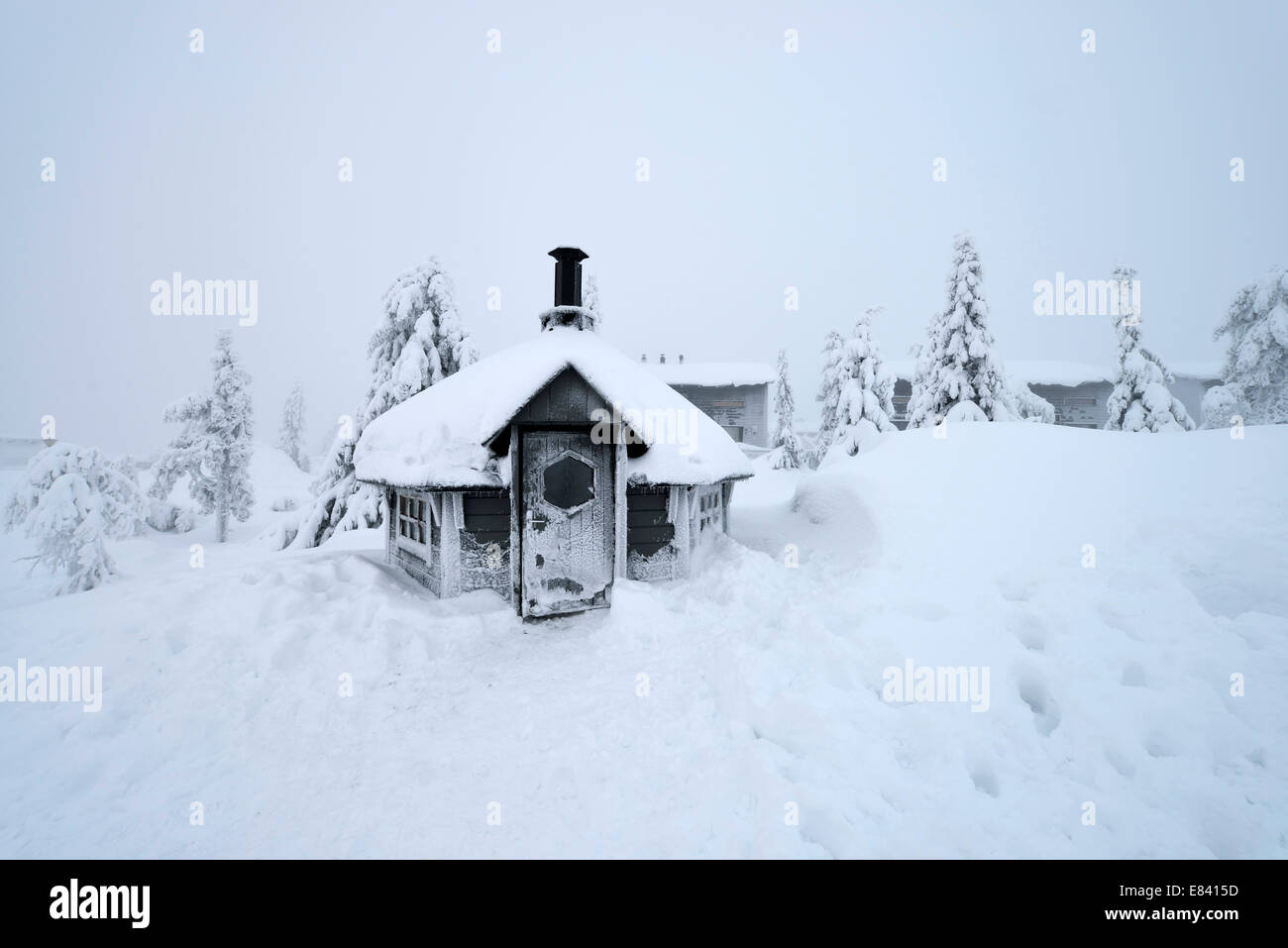 Finnish Kota in a snow-covered landscape, Iso Syöte, Lapland, Finland - Stock Image